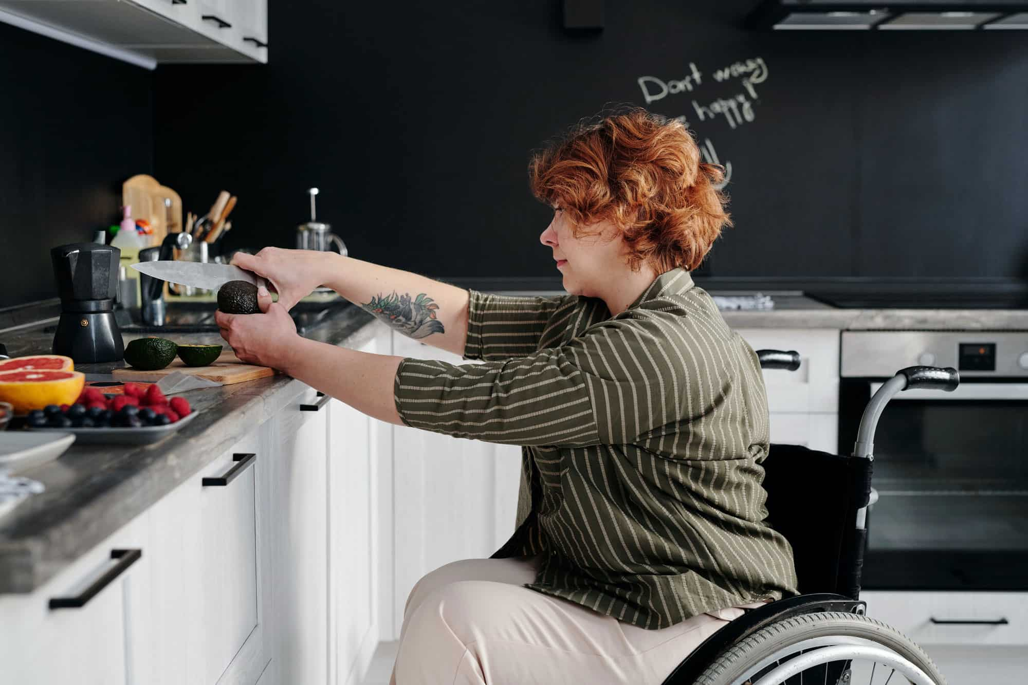 Self-Care woman in wheelchair cooking